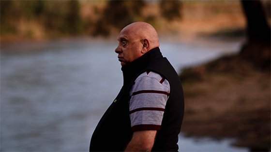 Image of Phil Duncan looking thoughtful out across a river in an rural setting.