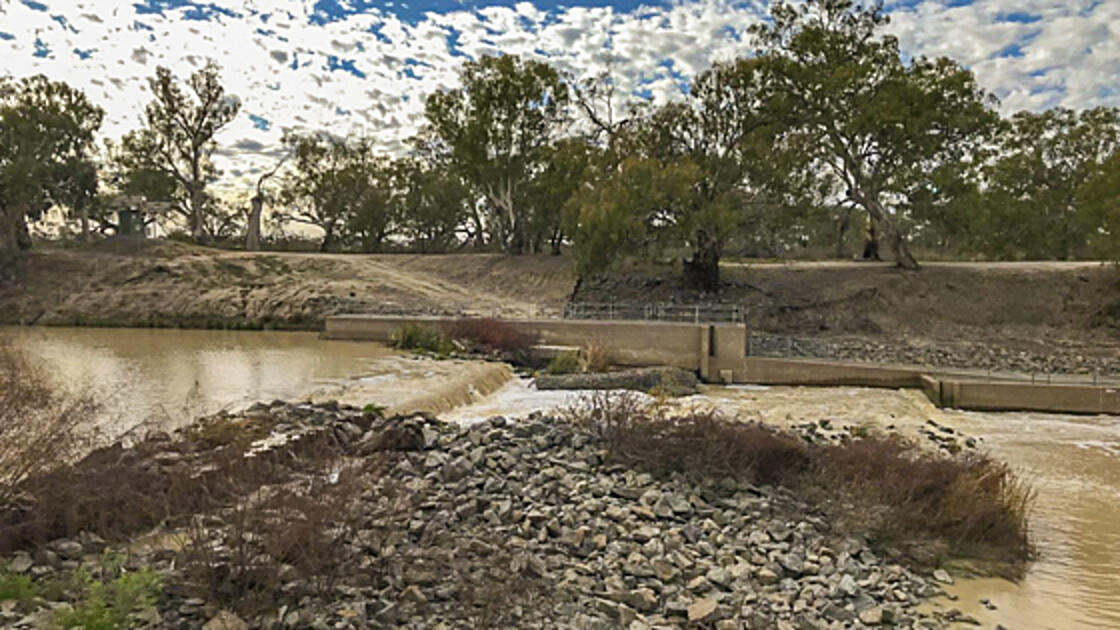 Water being released into a a semi-dry riverbed.